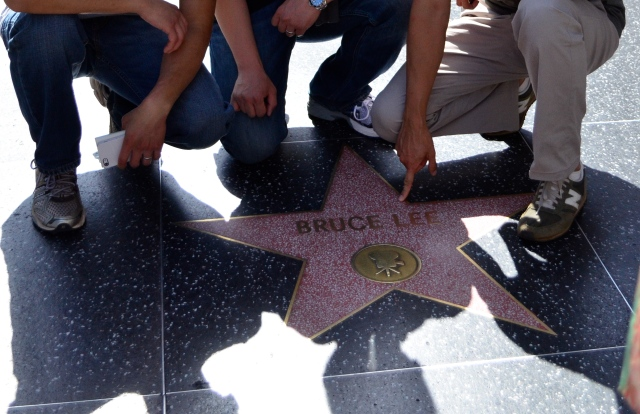 The boys had to pose with the Bruce Lee star.