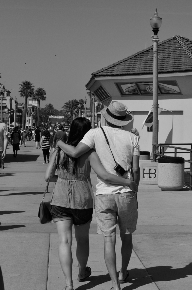Couples strolling on the pier.