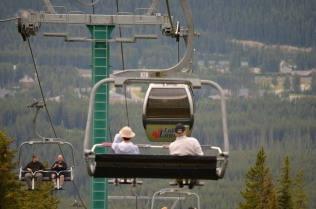 Mom and dad going down on the ski lift