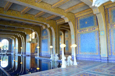 The indoor pool with marble steps and gold tiles.